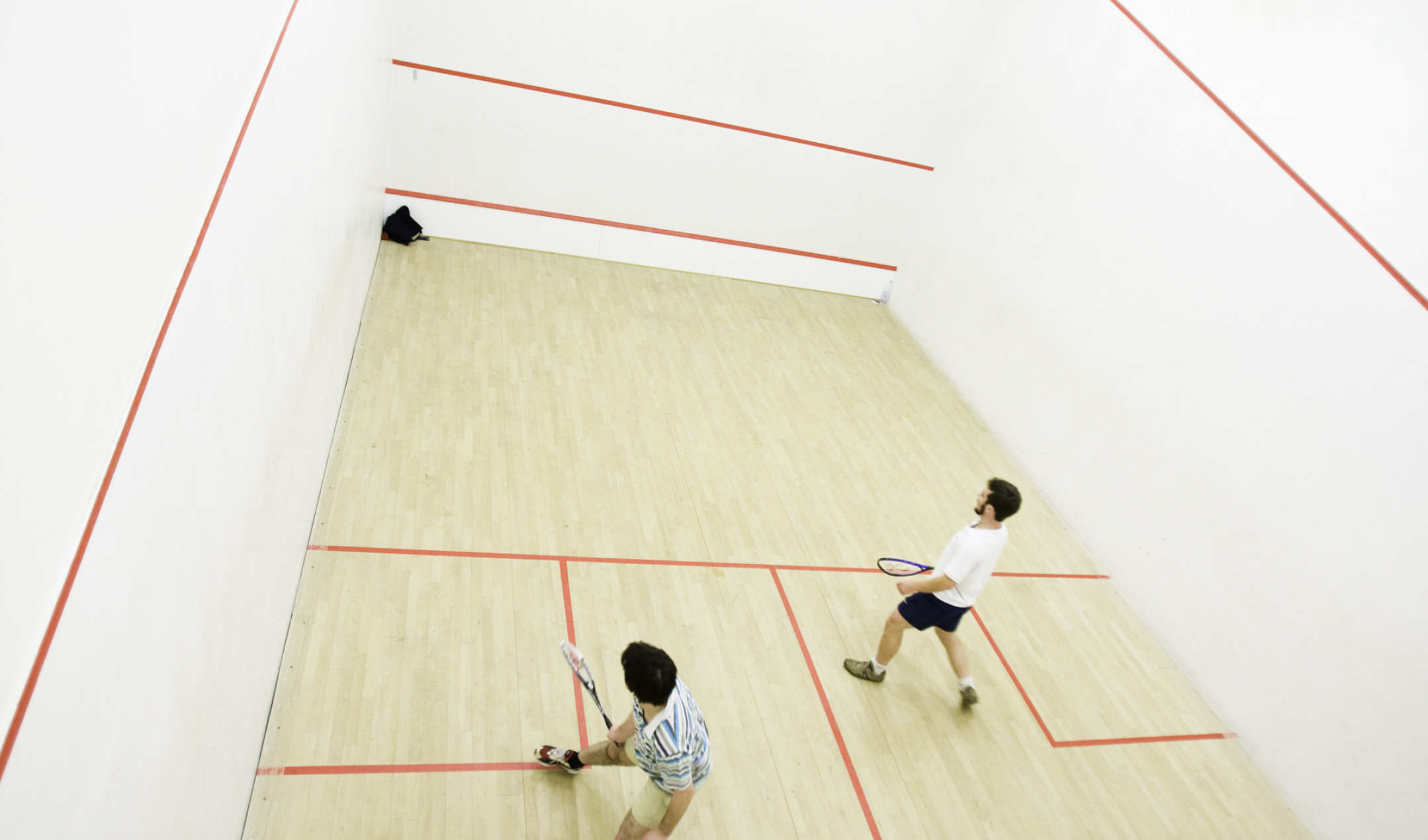 why do squash players touch the wall